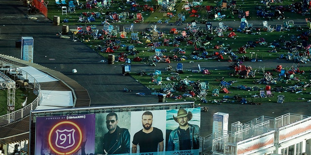 In this Oct. 3, 2017, file photo, personal belongings and debris litters the Route 91 Harvest festival grounds across the street from the Mandalay Bay resort and casino in Las Vegas.