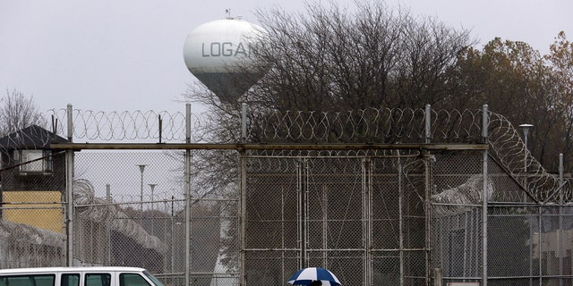 """Security fences surround the Logan Correctional Center Friday, Nov. 18, 2016, in Lincoln, Ill. Inmates at Illinois' main prison for women are demeaned as """"crazy"""" and """"worthless"""" by staff in a facility that offers little help to prepare women to re-enter the community, a study to be released Friday found."""