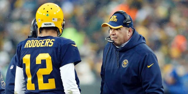 Green Bay Packers head coach Mike McCarthy talks to Aaron Rodgers during the first half of an NFL football game against the Philadelphia Eagles Sunday, Nov. 16, 2014, in Green Bay, Wis. (AP Photo/Mike Roemer)