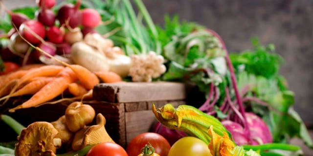 A selection of fresh organic vegetables on display.  Shallow dof
