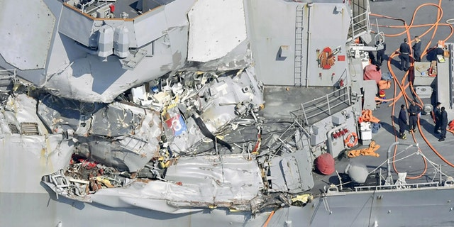 The damage of the right side of the USS Fitzgerald is seen off Shimoda, Shizuoka prefecture, Japan