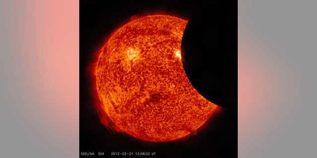 A partial solar eclipse, as observed by NASA's Solar Dynamics Observatory in February 2012.