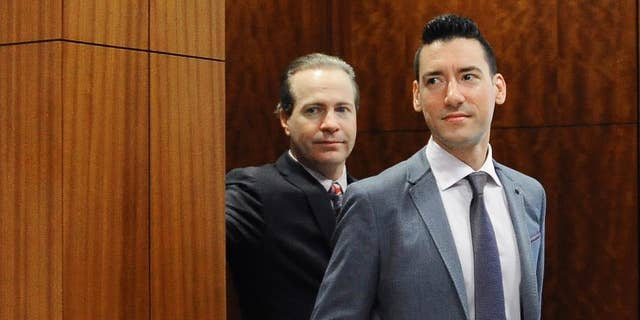 David Daleiden, right, leaves a courtroom after a hearing in Houston, April 29, 2016.