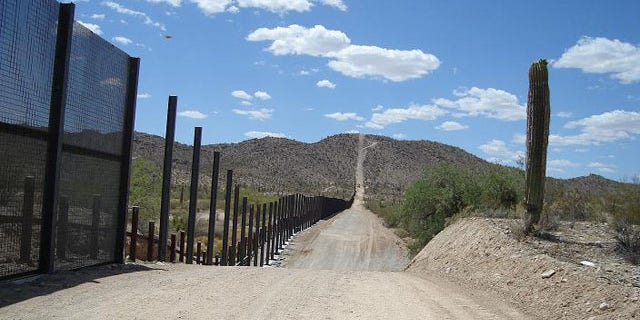 A pedestrian fence and a vehicle barrier are seen at Organ Pipe Cactus National Monument, near Lukeville, Ariz.