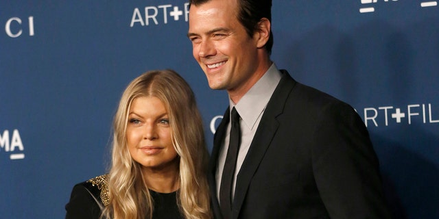 Actor Josh Duhamel and singer Fergie pose at an event in 2013.