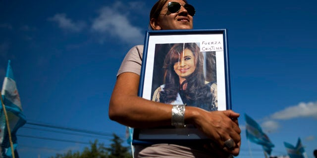 """Jan. 4, 2012: Rosa Calderon holds a picture of Argentina's President Cristina Fernandez that reads in Spanish """"Be strong Cristina"""" outside the hospital where Fernandez will undergo surgery for thyroid cancer in Pilar, Argentina. The 58-year-old leader has papillary thyroid carcinoma, and her doctors said it was detected before it spread, so her condition should curable without chemotherapy. Vice President Amado Boudou will be in charge during the operation on Wednesday and for 20 days as she recovers."""