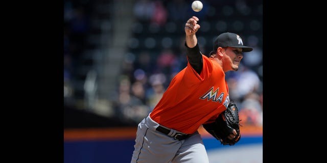 Miami Marlins starting pitcher Jose Fernandez pitches during the first inning of the baseball game against the New York Mets at CitiField Sunday April 7, 2013, in New York.  (AP Photo/Seth Wenig)