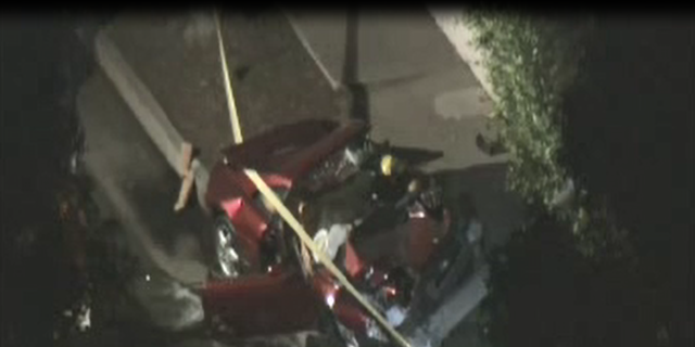 The Ferrari lost control and crashed into two vehicles before hitting a tree Tuesday night, officials said.