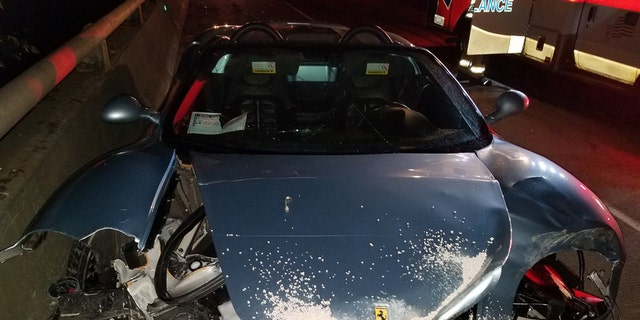 A huge chunk of a Ferrari appeared to be missing after an alleged drunken driver smashed it into a median.