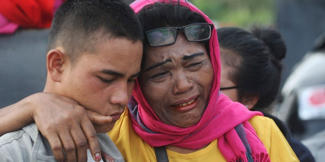 Relatives of the victims wait for news on any survivors.