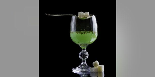 Absinthe glass with lump sugar