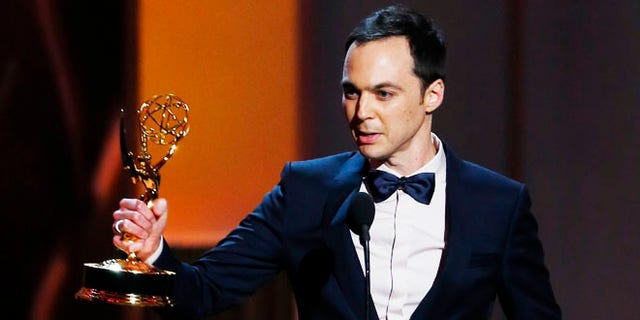 """Jim Parsons accepts the award for Outstanding Lead Actor In A Comedy Series for his role in """"The Big Bang Theory"""" at the 65th Primetime Emmy Awards in Los Angeles September 22, 2013.       REUTERS/Mike Blake (UNITED STATES  - Tags: ENTERTAINMENT)   (EMMYS-SHOW) - RTX13VVS"""