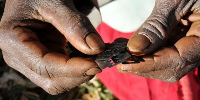 Razor blades often used before carrying out female genital mutilation. (REUTERS/James Akena)