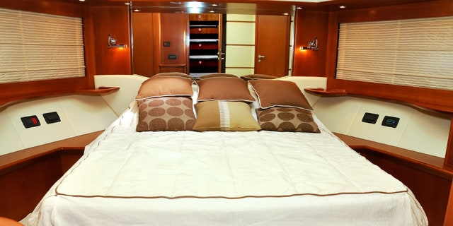 white bedroom motor yacht, close up