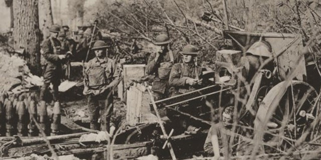 Howitzers belonging to the 106th Field Artillery are prepared for action during the Meuse-Argonne Offensive.