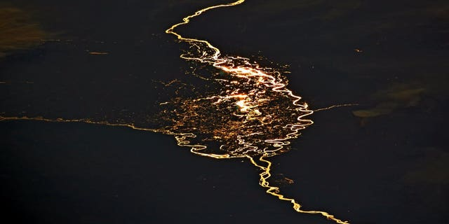 Astronaut Jack Fischer tweeted an fantastic image of the Cuando and Zambesi rivers with the sun glinting off them creating a stunning fiery reflection.