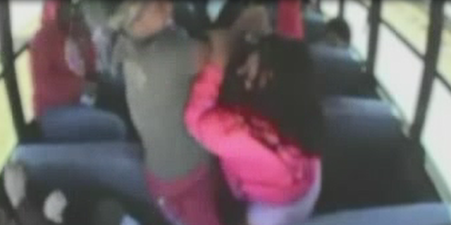 Two students were captured punching each other on a bus during an incident in April.