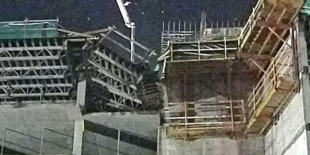 Two workers died early Wednesday after a scaffolding at a hotel near Walt Disney World Resort collapsed, authorities said.