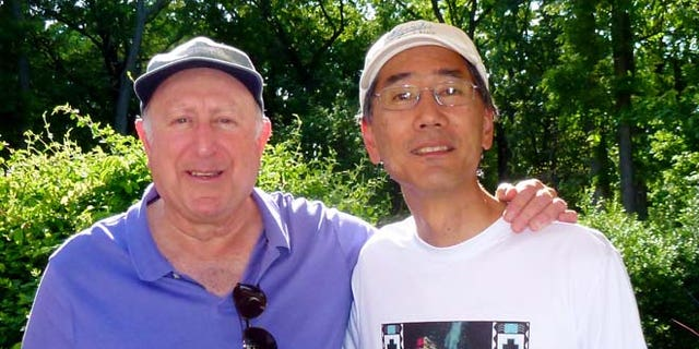 """Fine, shown here with photographer Stan Honda, whose iconic picture of Fine on 9/11 made him known as """"The Dustman."""""""