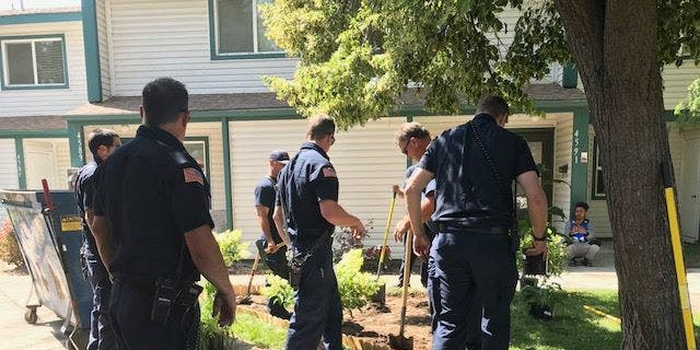 Firefighters with the Boise Fire Department work to build the memorial garden.