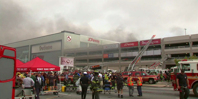 Multiple cars were ablaze at a parking garage in Kings Plaza Shopping Mall in Brooklyn.