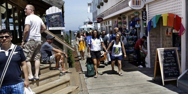 People get off the ferry in Cherry Grove, a beachfront community in New York popular with the LGBT crowd.