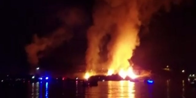 A fire broke out underneath an Independence Day fireworks show in Arizona Monday and was captured on camera.