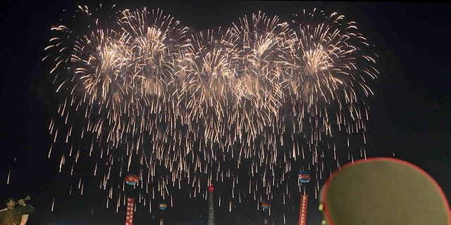 Soldiers watch fireworks in Kim Il Sung Square in Pyongyang, North Korea Thursday to celebrate the test launch of North Korea's first intercontinental ballistic missile two days earlier.