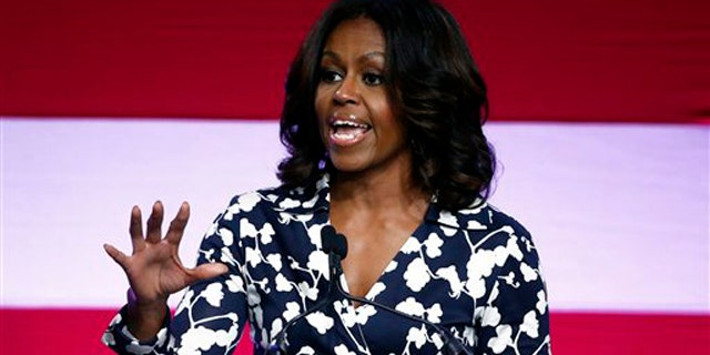 Oct. 23, 2014: First lady Michelle Obama campaigns for Sen. Mark Udall, D-Colo., during a rally pushing voters to re-elect the incumbent candidate, on the campus of Colorado State University, in Fort Collins, Colo.