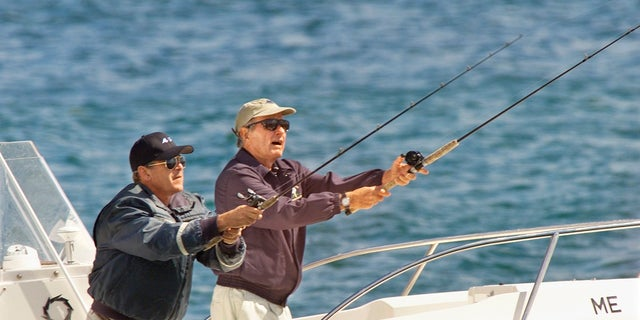 Former Presidents George Bush and George H.W. Bush go on a fishing outing near Kennebunkport, Maine, where the elder Bush resides part time.