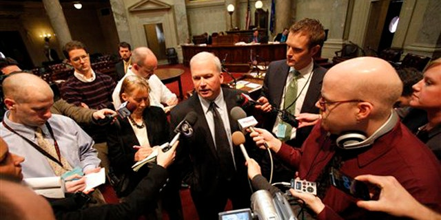 FILE: State Senate Majority Leader Scott Fitzgerald addresses the media on the Senate floor in Madison, Wis., Feb. 18.