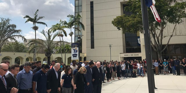 Hundreds gathered Monday around the Graham Center, the university's main hub, at 1:47 p.m. to remember the lives lost on Thursday.