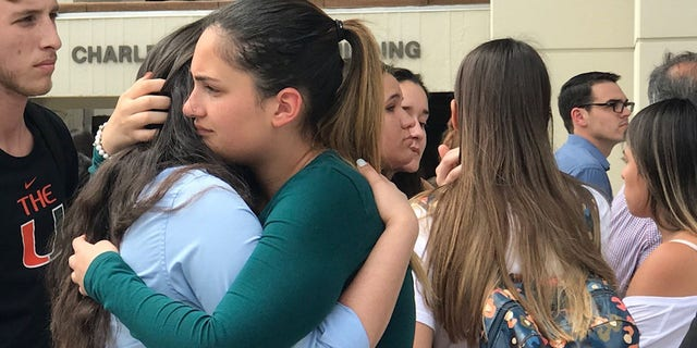 Friends of Alexa Duran, the 18-year-old FIU freshman killed in the collapse, comfort one another during the moment of silence on day when most students return to school after spring break.  (Fox News)