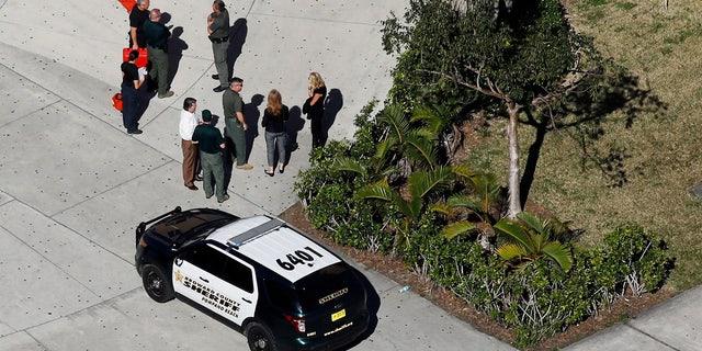 Feb. 16, 2018: Crime scene investigators are seen at Marjory Stoneman Douglas High School.