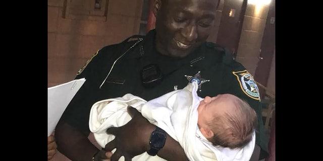 Gadsen County sheriff's Deputy Vontez Jackson was praised for helping find the infant.