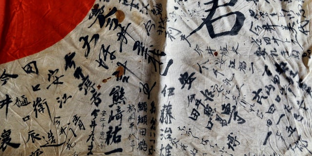 The flag contained names of the dead Japanese soldier's relatives and neighbors.