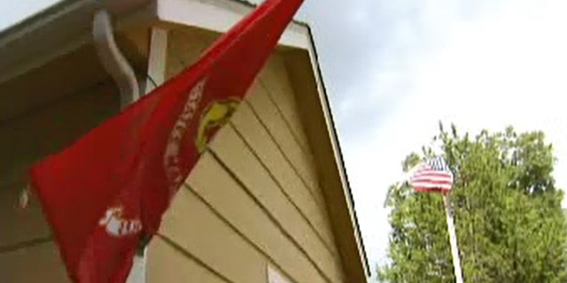 Howard Banks says vandals have previously shredded his United States and Marine Corps flags outside his Texas home.