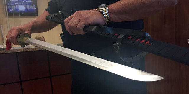 Police display the sword they say Daniel Seymour took out of his car during a road rage incident.