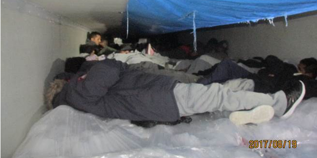 Sixty illegal immigrants were discovered Saturday in a cold tractor carrying vegetables.