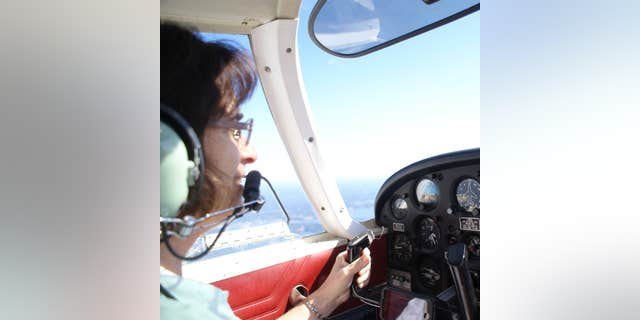 The author, Bev Weintraub, piloting her aircraft. (Credit: Philip F. Cianciolo)