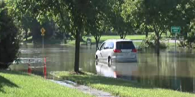 The minivan became trapped in floodwaters Tuesday.