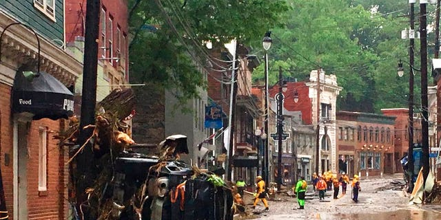 A car flipped to its side after flash floods in Ellicott City.