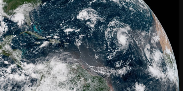 Hurricane Florence can be seen far out over the Atlantic Ocean on Tuesday.