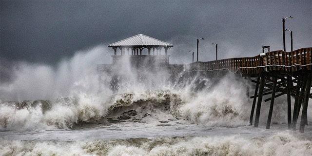 Waves slam the Oceana Pier & Pier House Restaurant in Atlantic Beach, North Carolina on Thursday as Hurricane Florence approaches the area.
