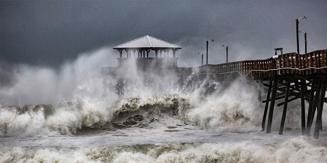 Waves slam the Oceana Pier & Pier House Restaurant in Atlantic Beach, North Carolina on Thursday as Hurricane Florence approaches the area.