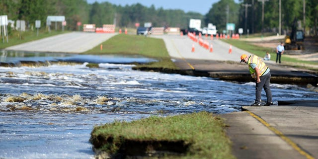 Flooding from Sutton Lake has washed away part of U.S. 421 in New Hanover County just south of the Pender County line in Wilmington, N.C., Friday, Sept. 21, 2018