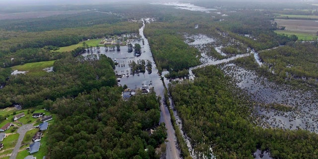 Floodwaters surround homes in the aftermath of Hurricane Florence in Newport, N.C., Monday, Sept. 17, 2018.