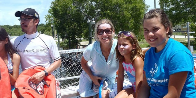 A photo shows the family who presumably lost their camera in Sanibel Island.