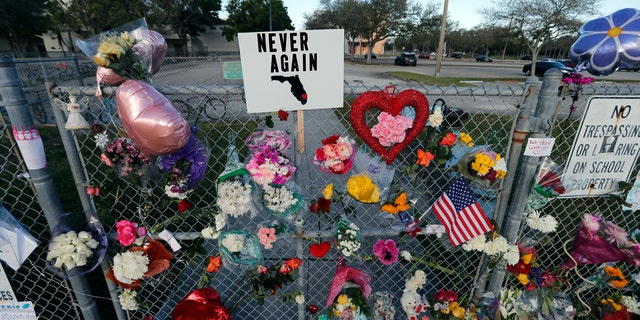 A makeshift memorial is seen outside the Marjory Stoneman Douglas High School, where 17 students and faculty were killed.