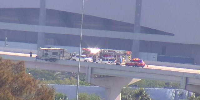 Rescue crews worked to secure a camper hanging from a Florida overpass.
